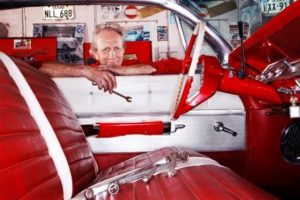 Red and white leather upholstery in a classic vintager vehicle.