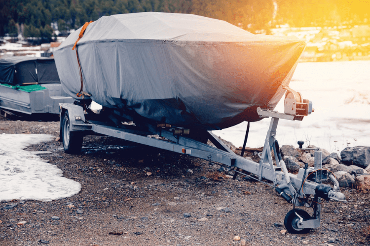 If you don't have the room to keep your boat indoors during the winter, covering it is your best option to keep it dry.