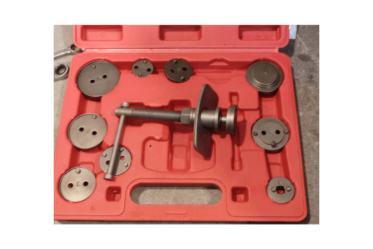 This is a compression piston tool. The kit comes with a bunch of adapters for various makes and models. This also works on the threaded style of caliper, provided the center hub is pinned.