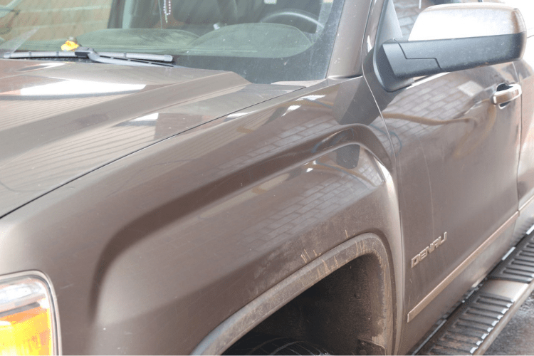 We started out with a 2015 GMC Denali Crew Cab truck that was pretty dirty. The Oklahoma red dirt is really hard to keep off of your paint.