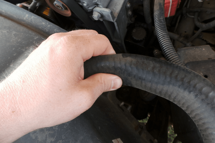 Check your hoses by pinching them (ONLY WHEN COOL!). If the hose collapses easily, then it needs to be replaced. Also look for cuts, abrasions, and bubbles.