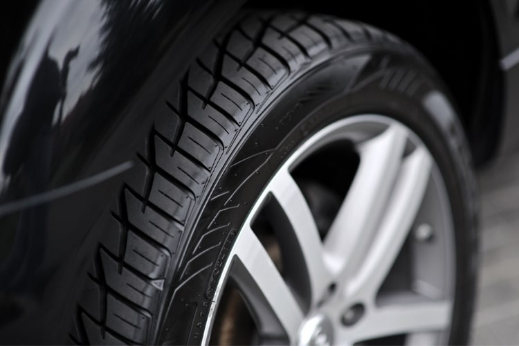 With a good quality product, a thin coat will still keep your tires looking polished.