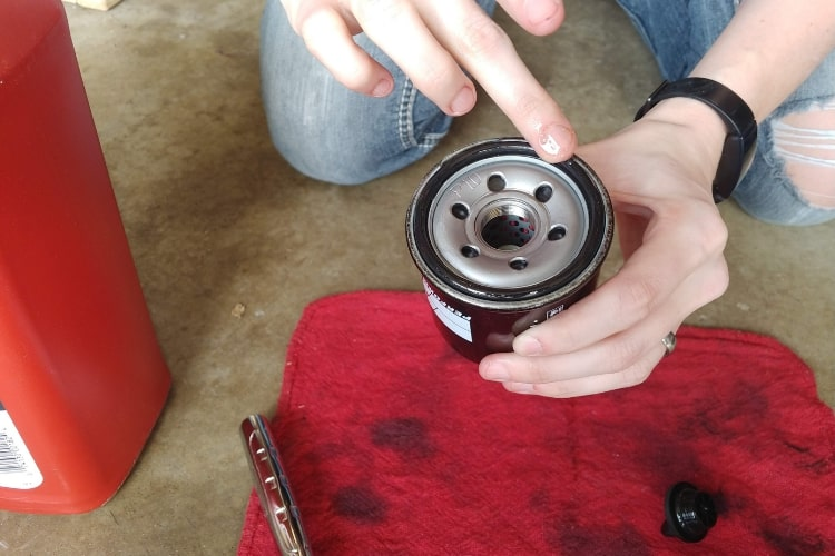 Ensure a good seal by applying oil to new oil filter o-ring.