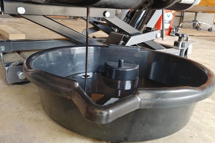 An oil drain pan is a must when changing motorcycle oil.