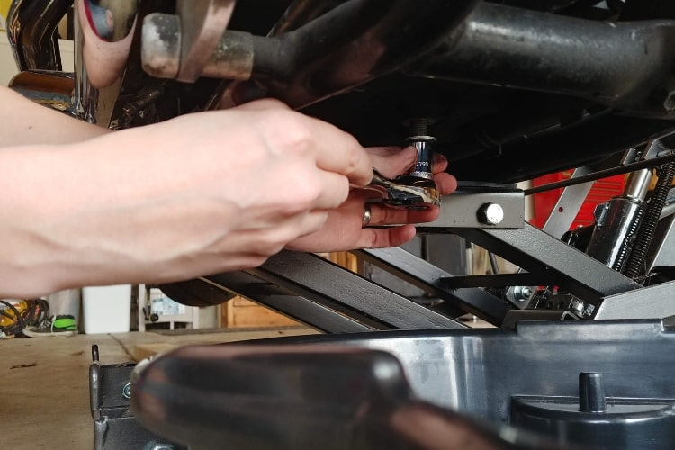 Carefully remove the oil pan drain bolt and set aside.