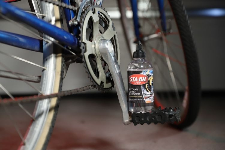 22406 sta bil bike chain cleaner lubricant bottle on pedal min