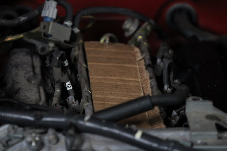 cardboard on engine from above min