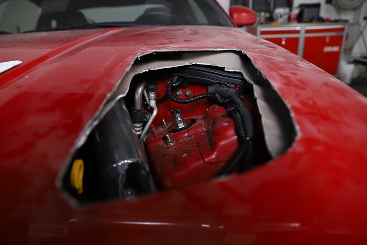 hood vent hole drivers side close up engine focus 1 min